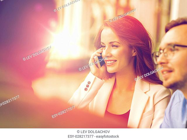 business, technology, communication and people concept - happy businesswoman calling on smartphone at office
