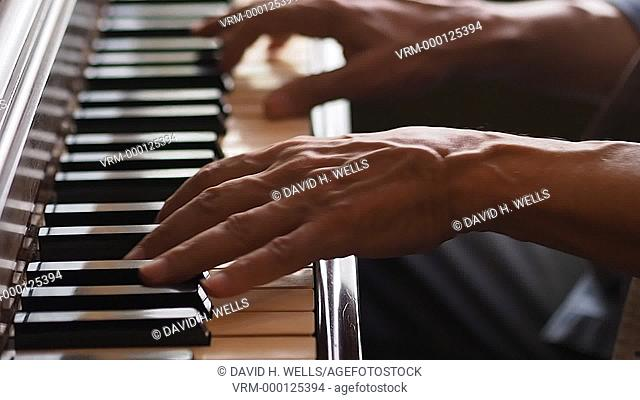 Hands of a musician playing piano in Providence, Rhode Island