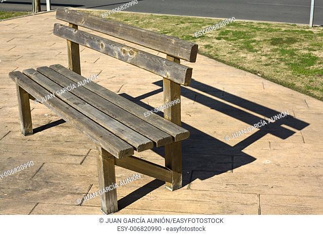 Rustic wooden bench in the park, Huelva, Spain
