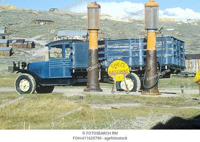 Antique delivery truck and gasoline pumps at Bodie, a CA ghost town