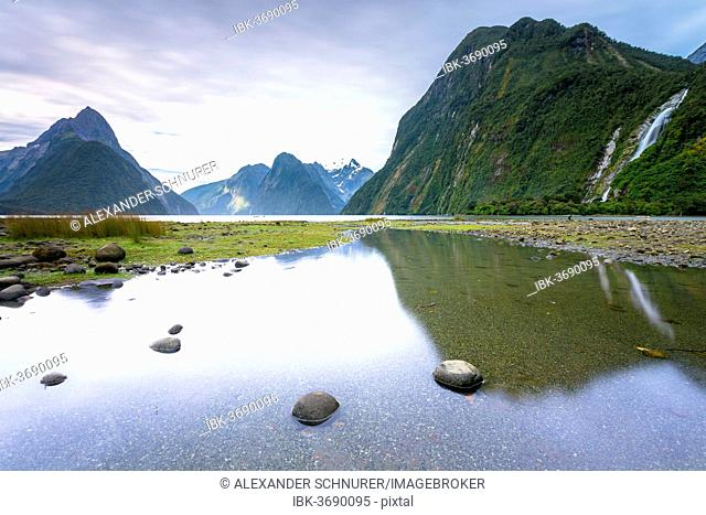 Evening at Milford Sound with Mitre Peak, 1683m, Cascade Peak, 1209m, and the Bowen Falls, 162m, Fiordland National Park, Southland Region, New Zealand