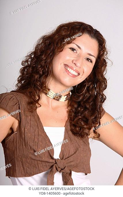Young woman posing smiling and looking at the camera