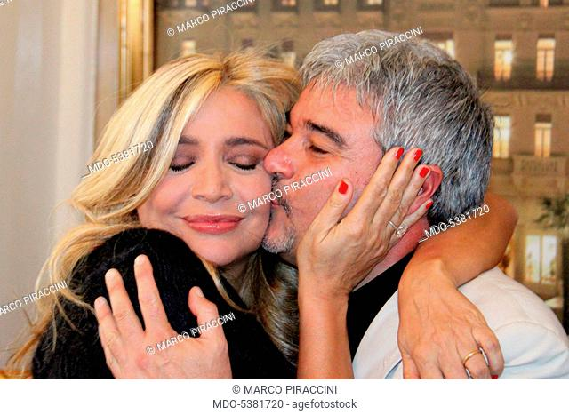 The TV presenter and actress Mara Venier (Mara Provoleri) and the actor and dubber Pino Insegno hugging each other. The two artists will present the New Year...