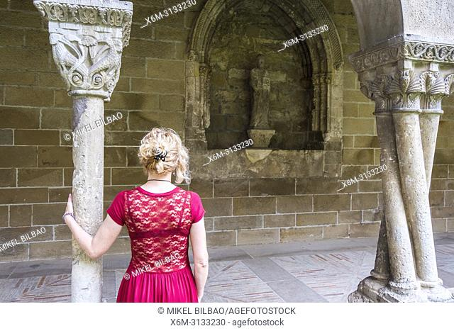 Woman in a cloister. San Pedro de la Rua church. Estella. Navarre, Spain, Europe