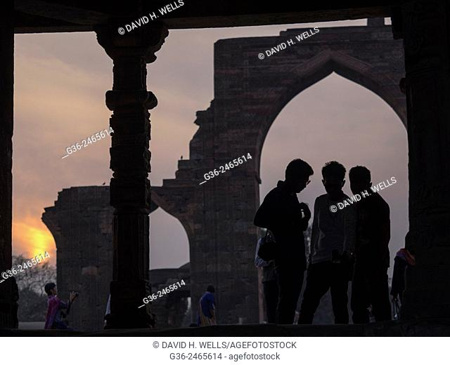 Silhouette of girls at Qutub Minar, New Delhi, India