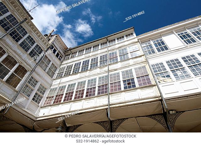 typical facade with balconies in the old town of Aviles, Asturias, Spain