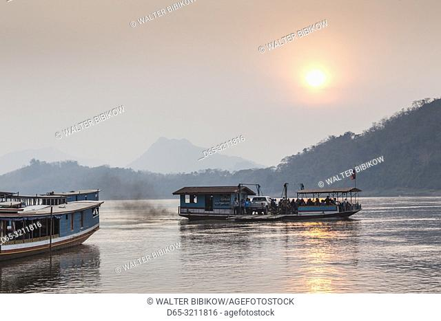 Laos, Luang Prabang, Riverboats on the Mekong River, sunset