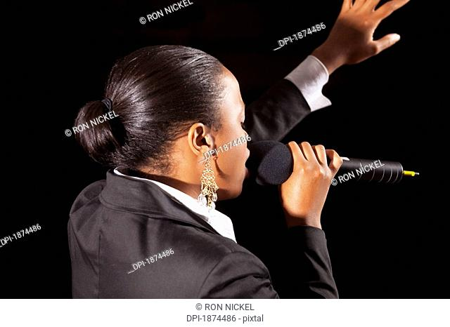Fort Lauderdale, Florida, United States Of America, A Woman Singing Into A Microphone And Leading Worship