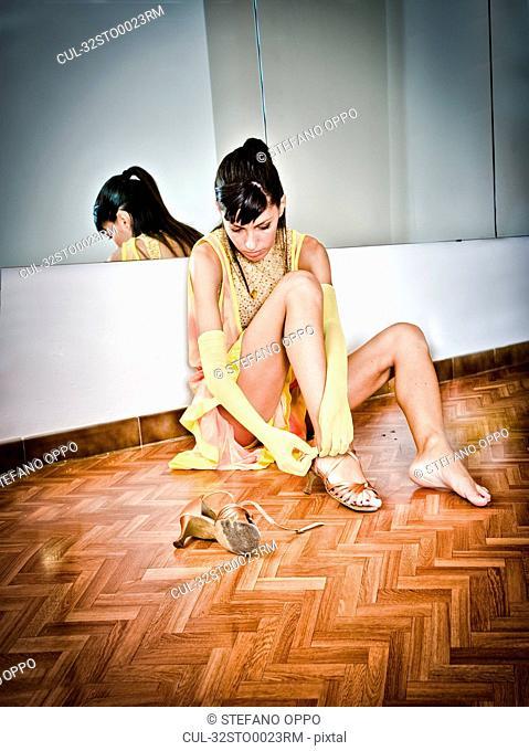 Dancer putting on high heels
