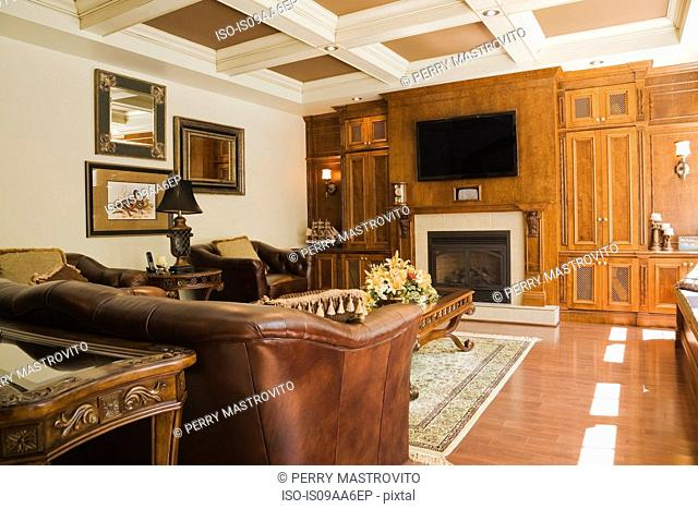 Traditionally styled sitting room with fireplace and flat screen television
