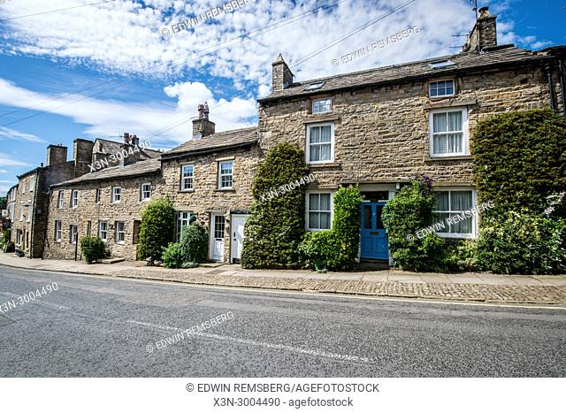 Row of historic town houses along roadway, Yorkshire Dales, UK