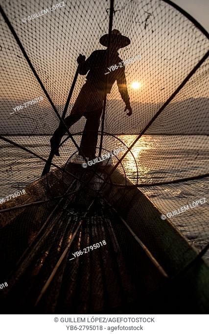 Silhouette of a Inle Lake Fisherman at work, Nyaungshwe, Shan State, Myanmar