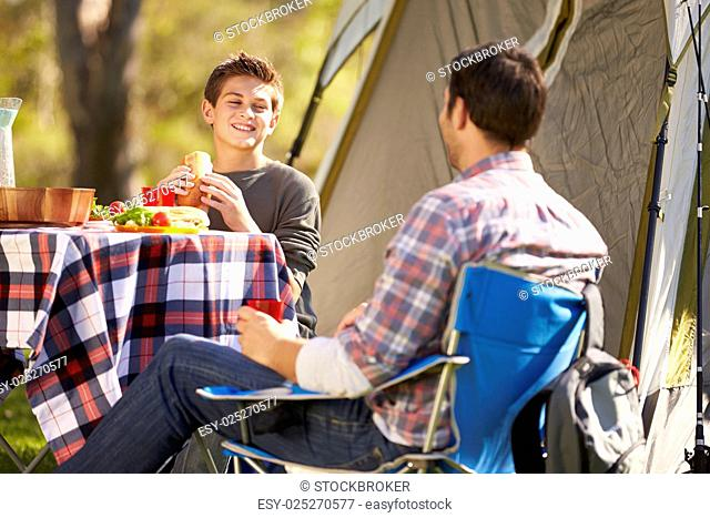 Father And Son Enjoying Camping Holiday In Countryside