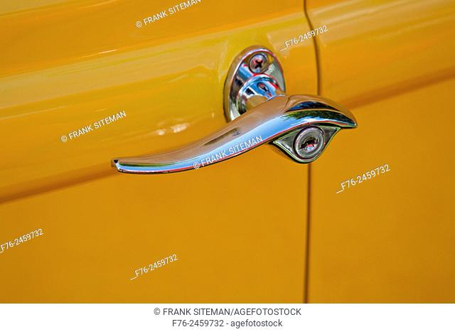 Chrome handle on antique yellow car door