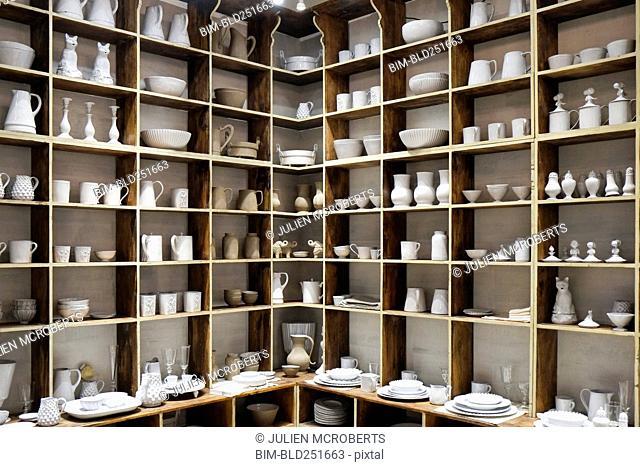 White ceramic pottery on shelves in store