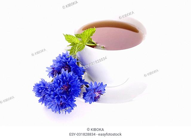 tea with mint and blue cornflowers