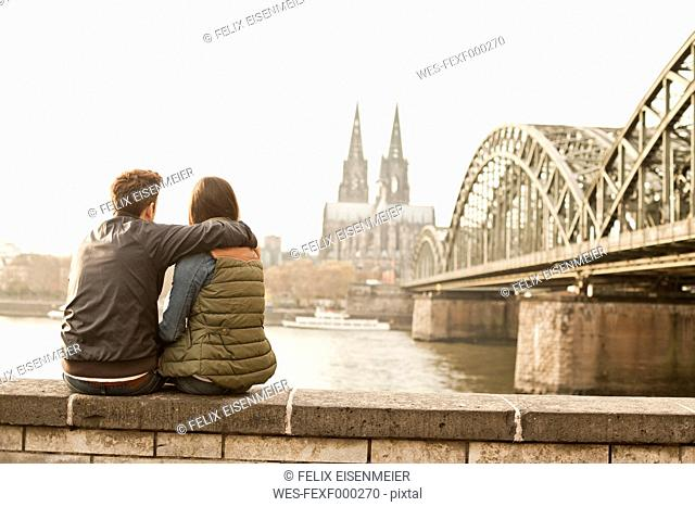 Germany, Cologne, happy young couple enjoying time