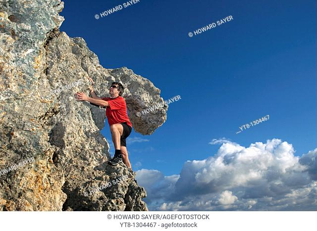 Man climbing rocks