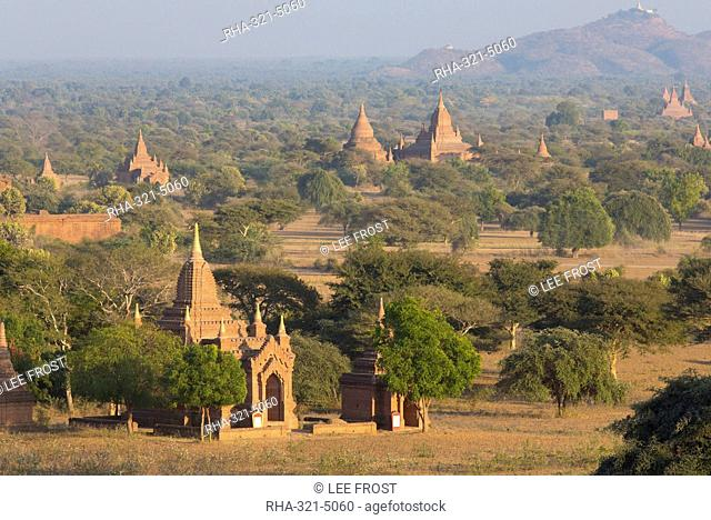 View over the temples of Bagan bathed in evening sunlight, from Shwesandaw Paya, Bagan, Myanmar (Burma), Southeast Asia
