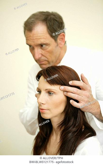 docotr giving advise to woman before face lift, plastic surgery