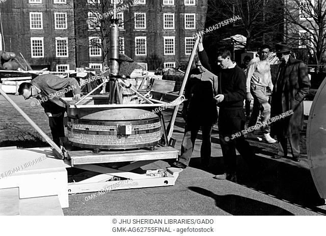 Astrophysics, Classes, Student Life Students and faculty are loading a balloon telescope, 1963