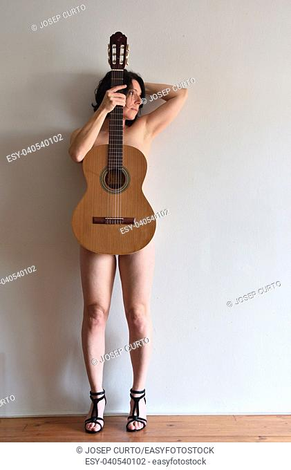woman with a guitar on her body