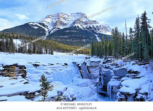 Mount Kekeslin behind frozen Athabasca Falls in winter, Jasper National Park, Alberta, Canada