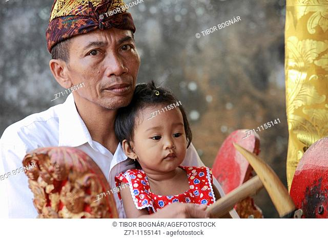 Indonesia, Bali, Mas, temple festival, people, odalan, Kuningan holiday, gamelan musician with daughter