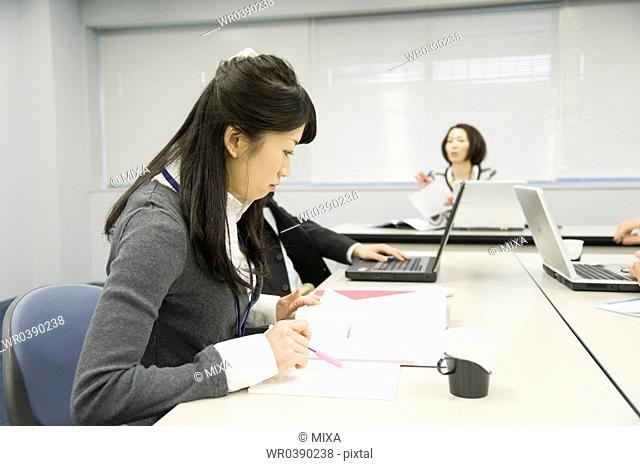 Businessmen and businesswomen working at office
