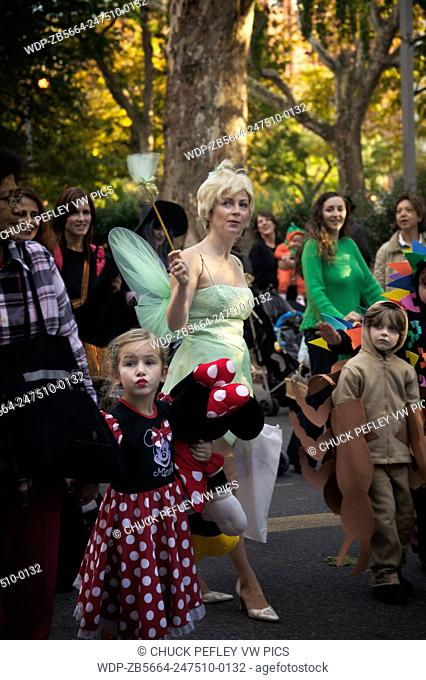 Children and adults in costumes march in the annual childrens Halloween parade at Washington Square in Greenwich Village, New York, NY
