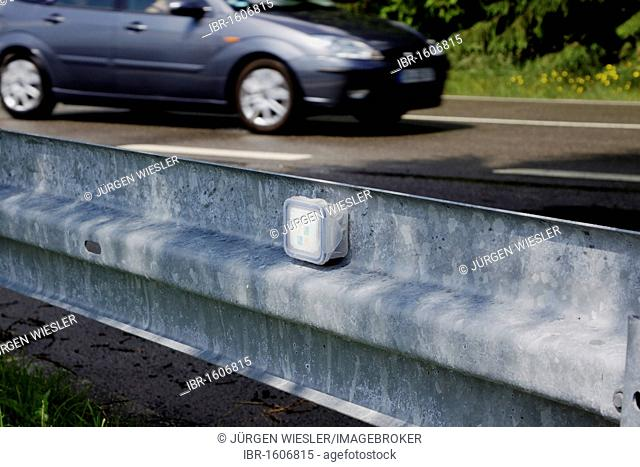 Mocache, simple geocache on the roadside, mounted on a guard rail, Germany, Europe