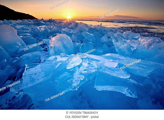 Stacked broken ice at sunset, Baikal Lake, Olkhon Island, Siberia, Russia