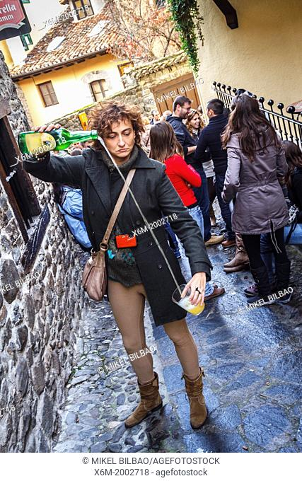 Cider in street life. Potes, Comarca de Liébana, Cantabria, Spain
