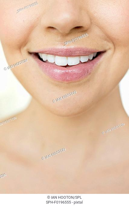 Woman smiling, close up