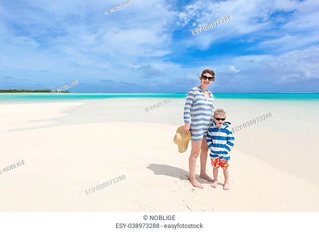 beautiful mother and her son at the gorgeous beach at aitutaki, cook islands