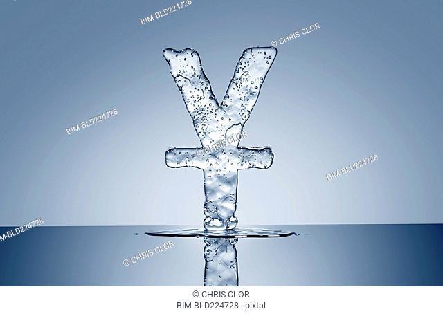 Puddle under melting ice yuan symbol