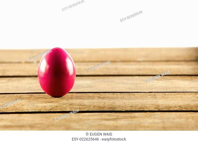Colorful easter eggs on old wooden background. Easter concept. The colorful painted Easter eggs