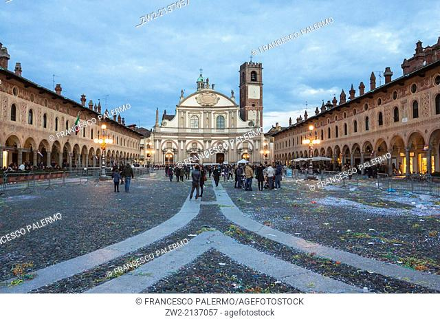 Central plaza after carnival's act at dusk. Vigevano, Lombardia. Italy