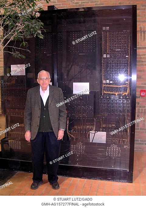 Full-length portrait of mathematician Arthur Burks posing with the ENIAC computer which he helped to design, University of Michigan, Ann Arbor, Michigan, 2004