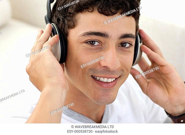 Teen guy listening to music with headphones