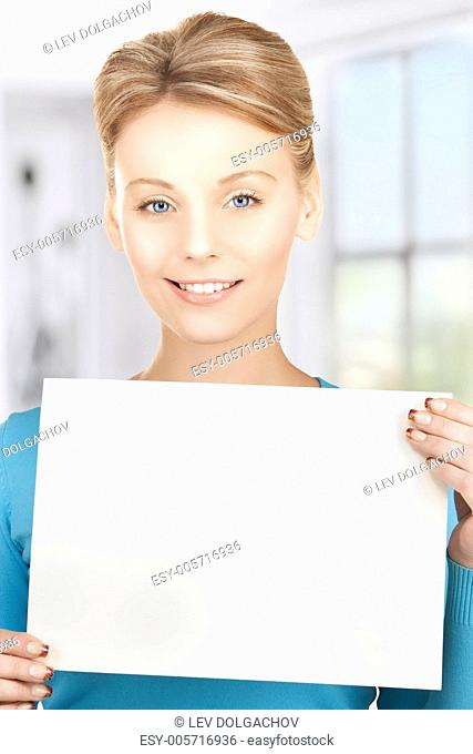 picture of happy smiling woman with blank paper