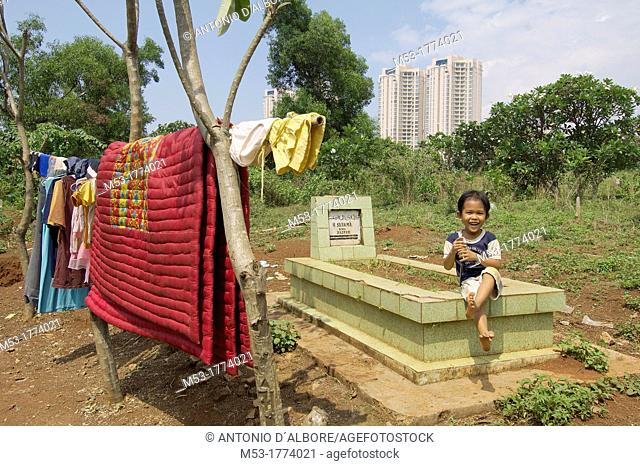 an indonesian boy living in a makeshift camp in Menteng Dalam Cemetery  jakarta  indonesia  asia