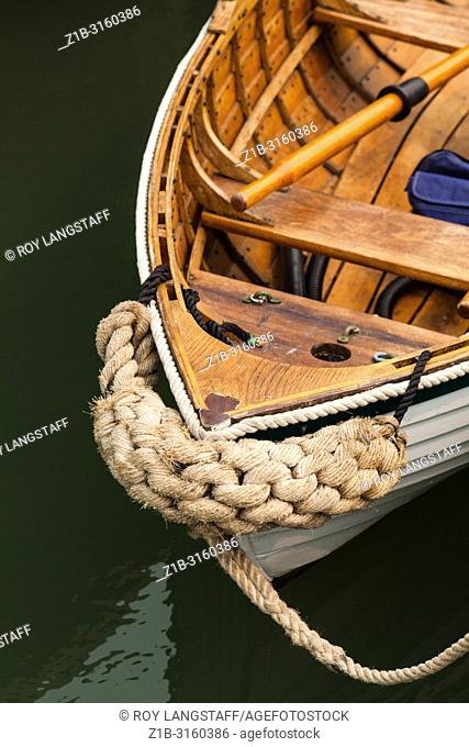 Decorative rope protection on the bow of a wooden dinhy