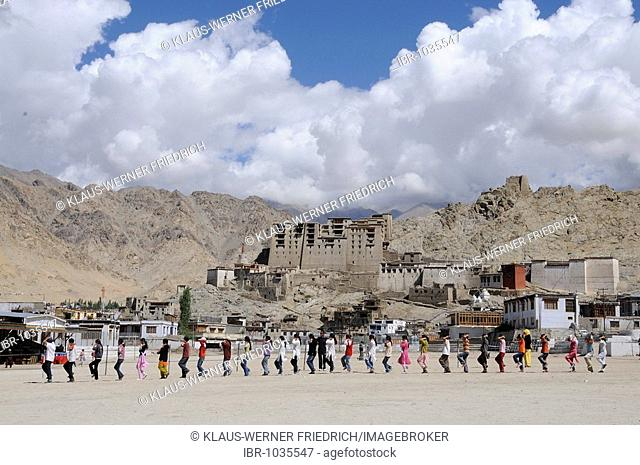 Ladakhi pupils training the march after an Indian school tradition in front of Leh Palace, Ladakh, North India, Himalaya, Asia