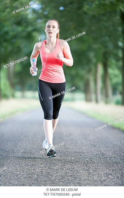 Woman jogging on road