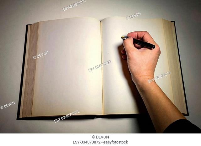 Blank white pages in an open hardcover book