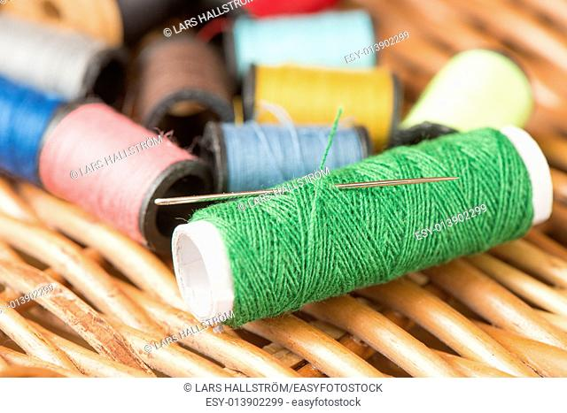 Closeup of thread used for sewing and needle