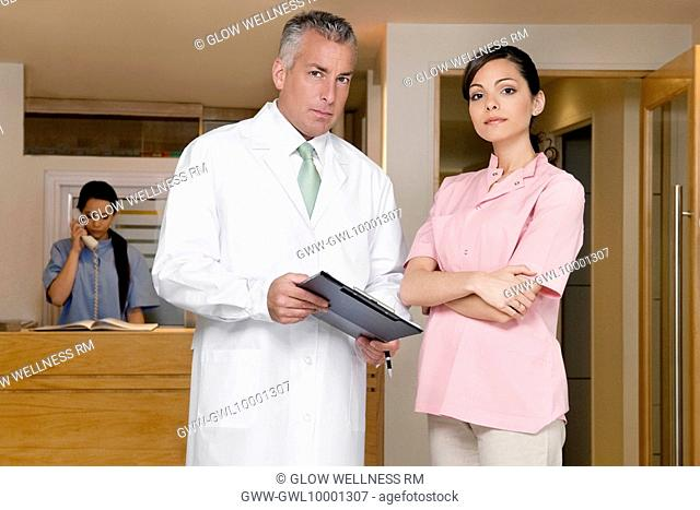Portrait of a female doctor with a male doctor