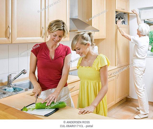 Young girl and women preparing meal
