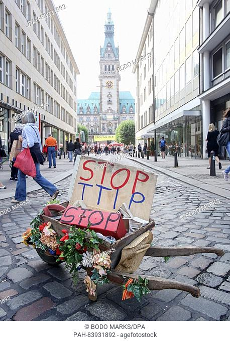 A wooden pushcart written with 'StopTTIP' can be seen on street near City Hall square during a large demonstration against the transatlantic trade agreements...